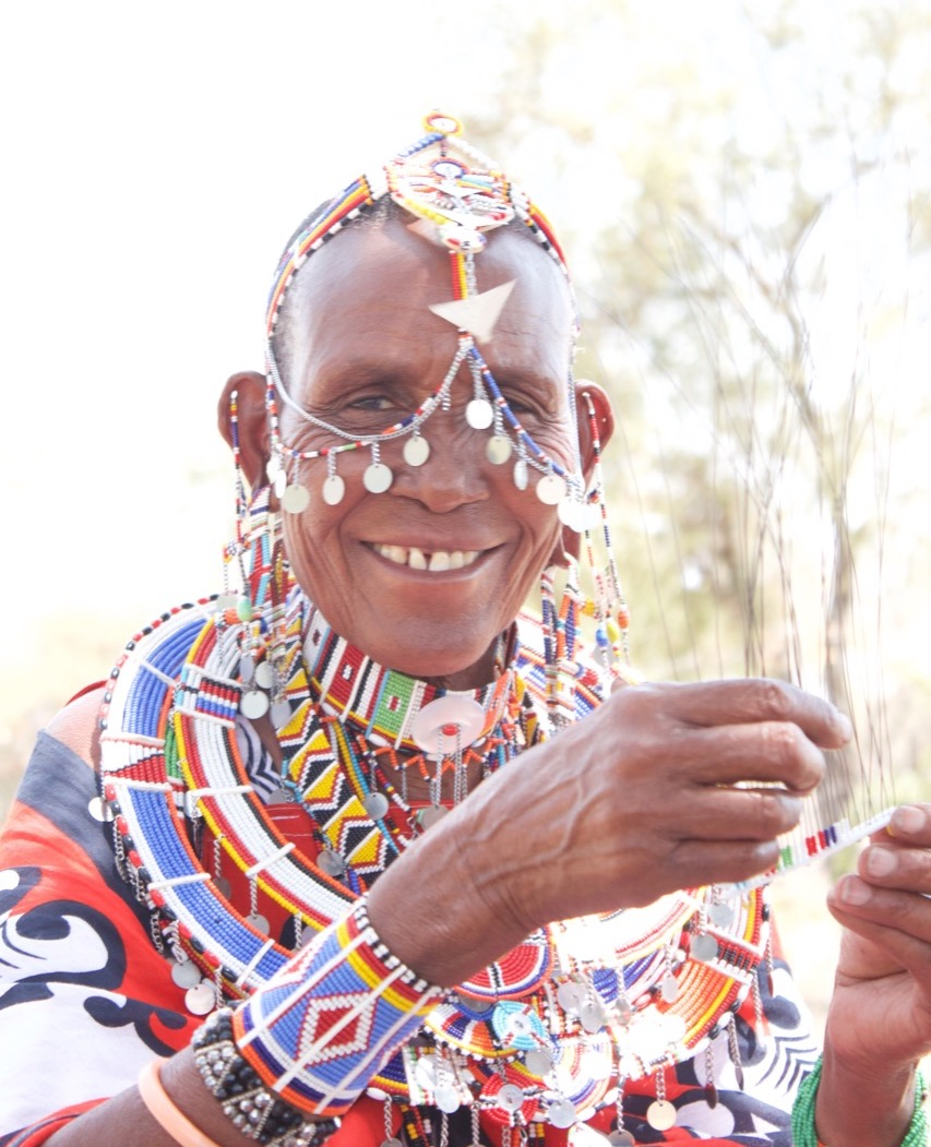 Maasai woman making jewellery